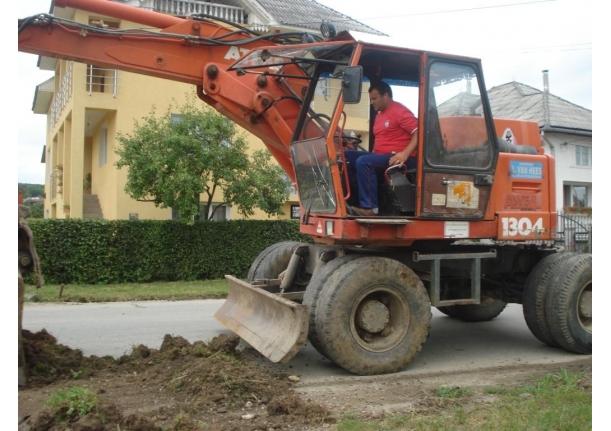 Decolmatare șanțuri în Fărcașa 26 iulie 2010